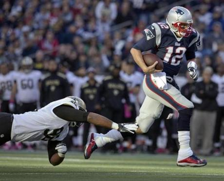 Brady ran past Tom Johnson in the first half.