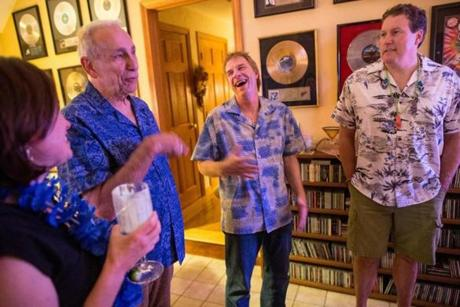 From left: Former WBCN DJ Charles Laquidara, Carter Alan, and WZLX DJ Chuck Nowlin at Alan's home recently.