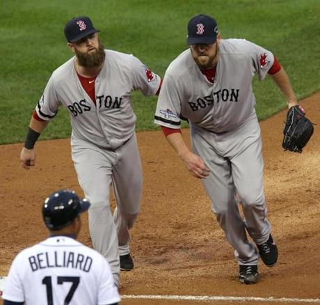 John Lackey got a pat on the back from Mike Napoli after getting the last out of the fifth inning.