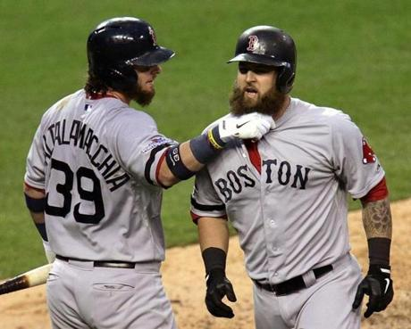 Mike Napoli received a celebratory tug on his beard at home plate from Jarrod Saltalamacchia.