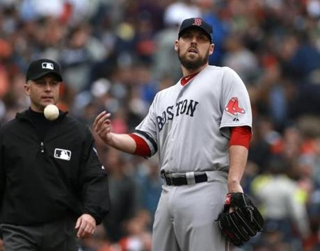 John Lackey reacted as a power outage forced a delay early in the game.