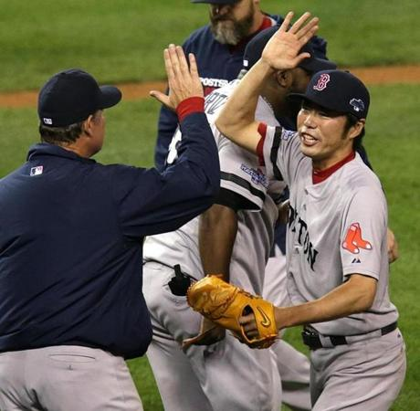 Koji Uehara received a high five from John Farrell after the win.