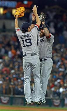 Koji Uehara, who recorded a four-out save, and Mike Napoli, who provided the only run of the game, leapt in celebration.