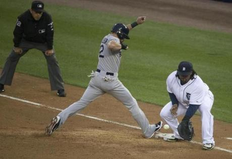 Jacoby Ellsbury returned safely to first as Prince Fielder took the throw.