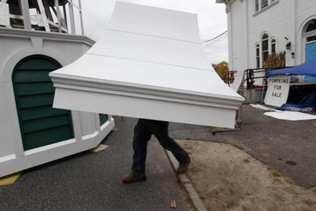 Oct 17 2013- Monson, Ma - Worker carries as section to be installed on spire before it is raised. on The First Church of Monson that was destroyed two years ago in tornado. ( globe staff photo: Joanne Rathe The Boston Globe metro reporter: peter schworm topic: 18monson)Oct 17 2013- Monson, Ma - Steeple raising on The First Church of Monson that was destroyed two years ago in tornado. ( globe staff photo: Joanne Rathe The Boston Globe metro reporter: peter schworm topic: 18monson)