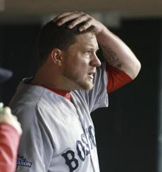 10-16-13: Detroit, MI: Pitcher Jake Peavy in the Red Sox dugout after he was removed from ALCS playoff game 4 between the Boston Red Sox and Detroit Tigers at Comerica Park in Detroit, Michigan Oct. 16, 2013. Photo/Jim Davis, Boston Globe staff story/