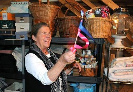 Wedding planner Joanna Fairchild at home amid her store of wedding supplies in Oak Bluffs.