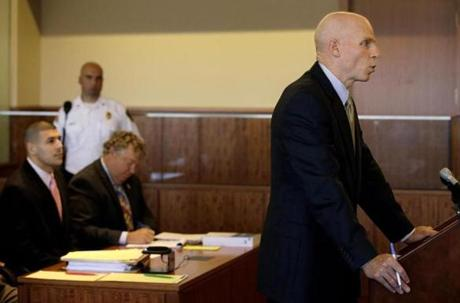 Prosecutor William McCauley (right), argued to have Judge E. Susan Garsh recuse herself from the murder trial of former New England Patriots tight end Aaron Hernandez (far left) in Bristol Superior Court Monday.