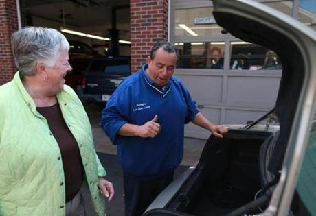 Neil Murley of Murley's Car Care Center in Weymouth, speaking with customer Judy Fuller, left, favors the local ban on pumping your own gas.