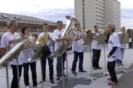 Seiji Ozawa (right) leads the BSO brass section in a couple of Red Sox-related tunes on the roof of Symphony Hall.