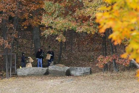 Investigators gathered evidence in the woods behind Danvers High School, where the body of 24-year-old teacher Colleen Ritzer was found.