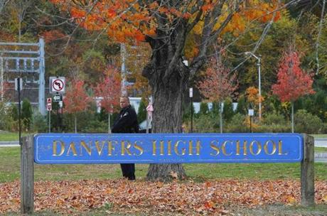 A police officer guarded the entrance to Danvers High School. Classes were canceled at all Davers schools for the day.