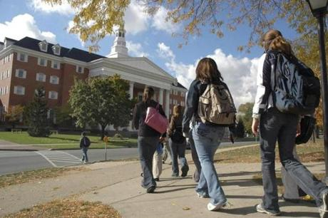 Students head toward the Billy Graham Center on the Wheaton College campus.