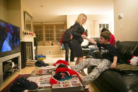 Tricia O'Connell tried to pull her son, Jamie Schumacher, off the couch to send him to bed.
