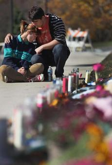 Senior Cameron Trout comforted junior Kelsey Brooks at Danvers High School.