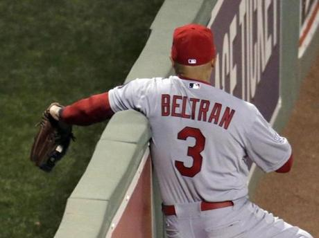 Cardinals right fielder Carlos Beltran took a home run away from David Ortiz, but suffered a rib contusion and ended up leaving the game.