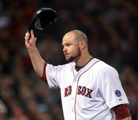 Lester tipped his cap as left the game in the eighth inning to a standing ovation.