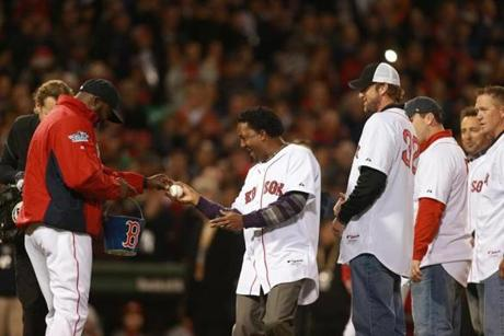Ortiz handed former Red Sox Pedro Martinez a ball for the ceremonial firs