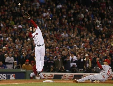 Stephen Drew tried to catch Breslow's throw to third.