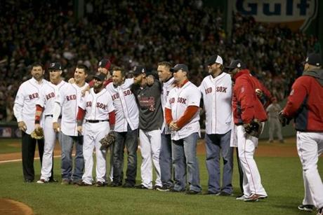Members of the 2004 Red Sox World Series team gathered on the field before Game 2.