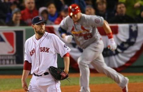Cardinals Matt Adams singles while Red Sox John Lackey watchs the ball go to left field in the sixth inning during game two of the World Series between the Boston Red Sox and St. Louis Cardinals Thursday, Oct. 24, 2013. (John Tlumacki/Globe Staff)