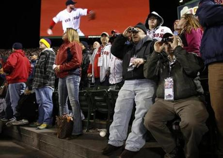 Fans used binoculars to watch the first inning of Game 2 of the World Series.