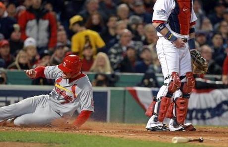 Holliday scored the first run of the game on Molina's hit.