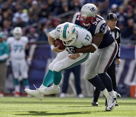 Dont'a Hightower sacked Tannehill in the third quarter.
