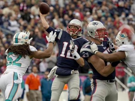 Brady threw a 14-yard touchdown pass to Aaron Dobson with pressure from the Dolphins' Philip Wheeler.