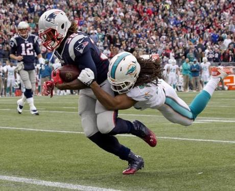Brandon Bolden carried the ball into the end zone despite attempts to stop him in the third quarter.