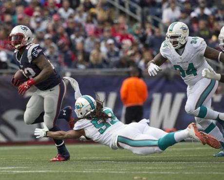 Stevan Ridley ran past Philip Wheeler for a 23-yard rushing gain in the third quarter.