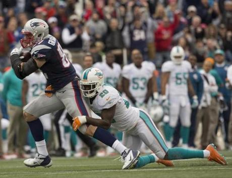 Rob Gronkowski was tackled by Reshad Jones after a 23-yard reception in the third quarter.