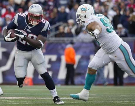 Brandon Bolden ran past Jared Odrick in the fourth quarter.