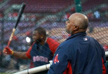 Enrique Ortiz watched from behind the cage  as his son, David Ortiz, took batting practice.