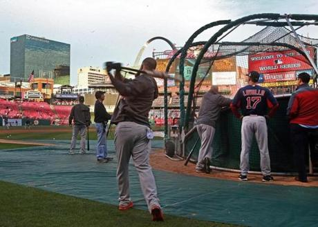 Mike Napoli used a weighted bat before taking his turn in the batting cage.