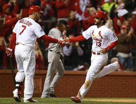 Carlos Beltran's line drive scored Matt Carpenter (right), who was congratulated by teammate Matt Holliday in the third inning.