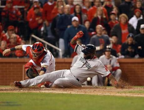 Ortiz slid safely to home plate, and the Red Sox tied the game at a run apiece in the fifth inning.