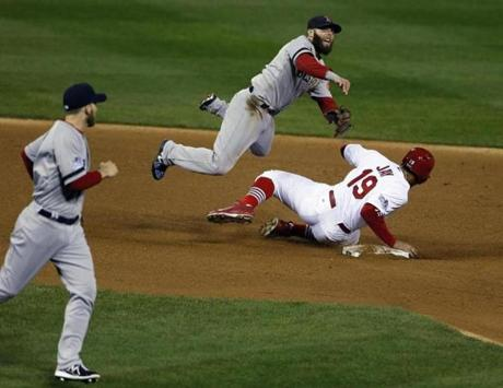 Pedroia threw to first base after tagging out Jon Jay.