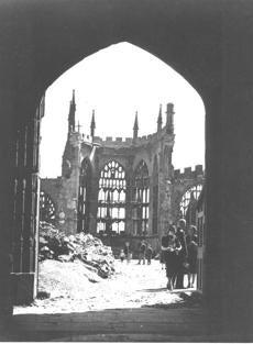 Visitors view the ruins of Coventry Cathedral in Coventry, England in 1941. Only a stone skeleton remains following the Nazi air raid of Nov. 14, 1940. (AP Photo)