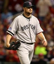 Jon Lester walked to the dugout at the end of the third inning.