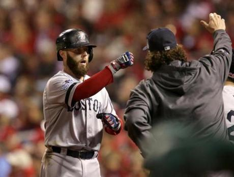 Dustin Pedroia was welcomed by teammates after scoring.