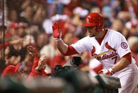 Matt Holliday received high fives after his home run in the fourth inning.