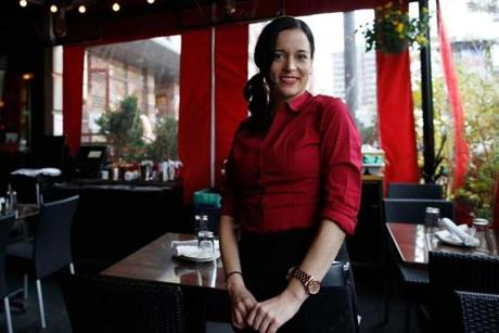 "Rebecca Lewis served more customers at Eastern Standard. ""They're ready to lay down a little cash — or a lot,"" she said."