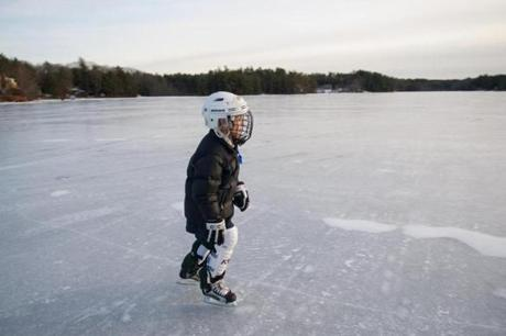 Reese Bower, author Jay Atkinson's nephew, wears a helmet and other hockey gear to protect against falls.