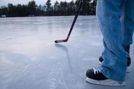 At Phillips Pond a hockey stick is a must, serving as a probe to test discolored patches of ice as well as a necessary piece of pond hockey equipment.