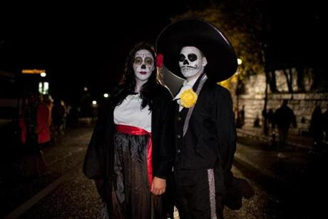 Megan Vassilio (left) and Alejandro Rubilar wore Day of the Dead costumes.
