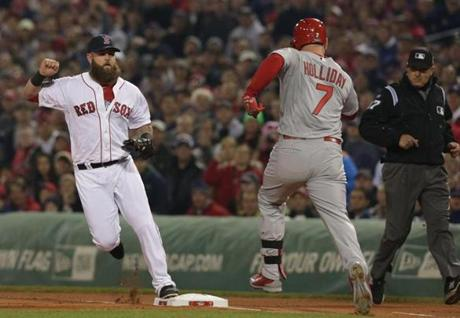 Mike Napoli retired the Cardinals' Matt Holliday at first base in the first inning.