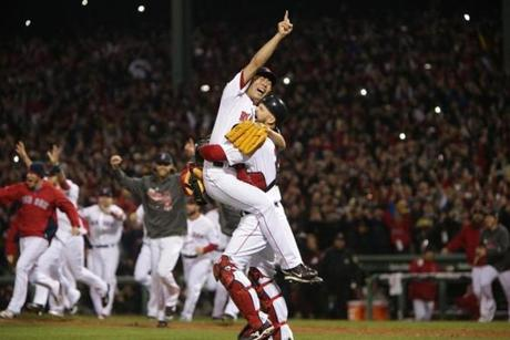 Koji Uehara got a lift from David Ross after throwing the final strike.