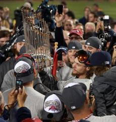 Red Sox pitcher Clay Buchholz held the championship trophy.