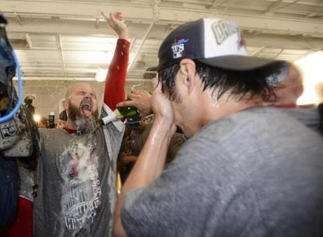 David Ross (left) and Koji Uehara celebrated.